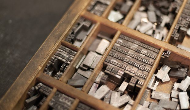 Close-up of metal letterpress letters in printing machinecolor image, canon 5DmkII